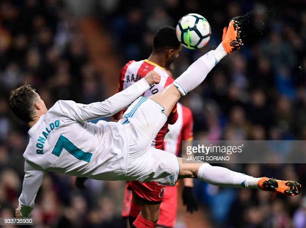 TOPSHOT Real Madrid's Portuguese forward Cristiano Ronaldo vies with Girona's Spanish defender Jonas Ramalho during the Spanish League football match...