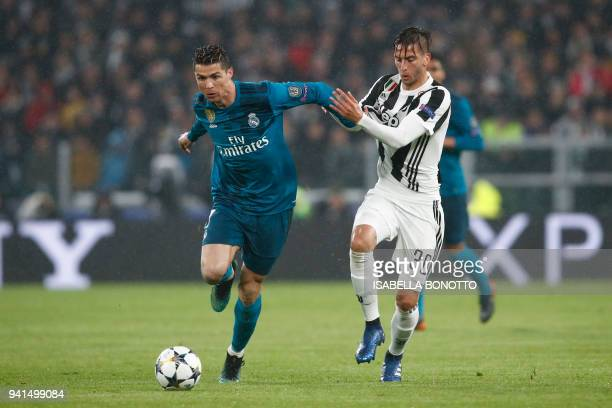 Real Madrid's Portuguese forward Cristiano Ronaldo vies with Juventus' midfielder from Uruguay Rodrigo Bentancur during the UEFA Champions League...