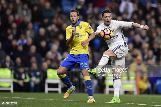 TOPSHOT Real Madrid's Portuguese forward Cristiano Ronaldo vies with Las Palmas' defender Daniel Castellano during the Spanish league football match...