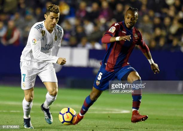 Real Madrid's Portuguese forward Cristiano Ronaldo vies with Levante's Yvorian midfielder Cheik Doukoure during the Spanish league football match...
