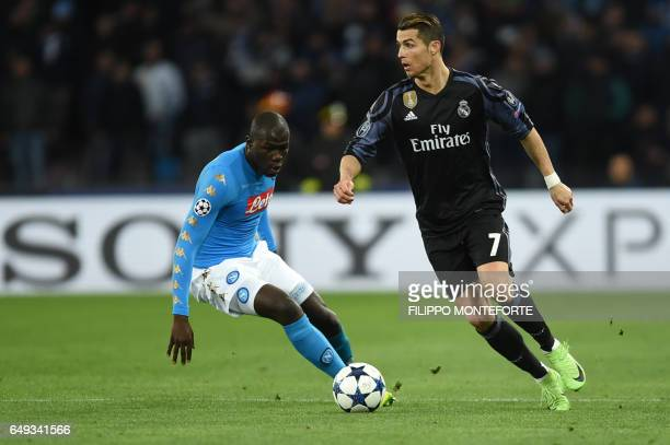 Real Madrid's Portuguese forward Cristiano Ronaldo vies with Napoli's defender from France Kalidou Koulibaly during the UEFA Champions League...