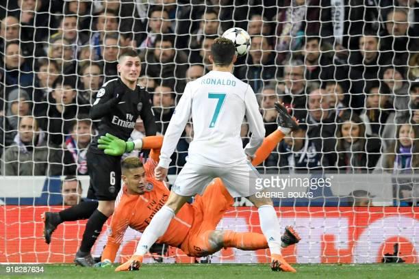 TOPSHOT Real Madrid's Portuguese forward Cristiano Ronaldo vies with Paris SaintGermain's French goalkeeper Alphonse Areola and Paris SaintGermain's...