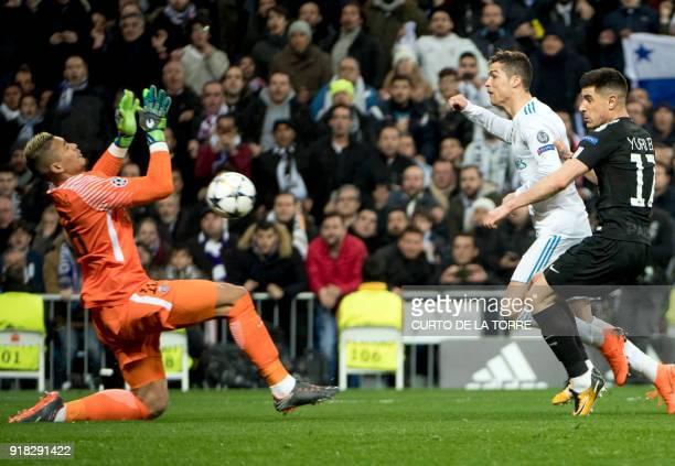 Real Madrid's Portuguese forward Cristiano Ronaldo vies with Paris SaintGermain's Spanish defender Yuri Berchiche in front of Paris SaintGermain's...