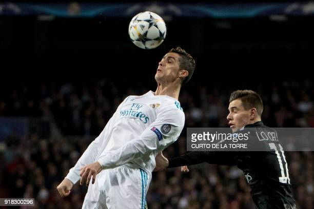 TOPSHOT Real Madrid's Portuguese forward Cristiano Ronaldo vies with Paris SaintGermain's Argentinian midfielder Giovani Lo Celso during the UEFA...
