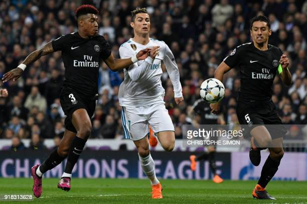 Real Madrid's Portuguese forward Cristiano Ronaldo vies with Paris SaintGermain's French defender Presnel Kimpembe and with Paris SaintGermain's...