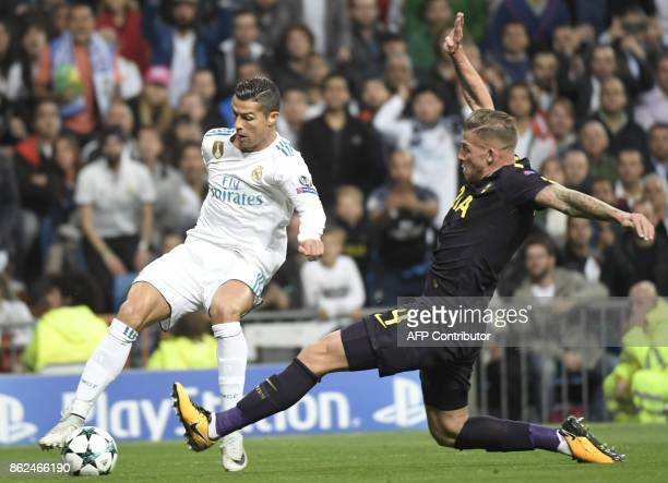Real Madrid's Portuguese forward Cristiano Ronaldo vies with Tottenham Hotspur's Belgian defender Toby Alderweireld during the UEFA Champions League...