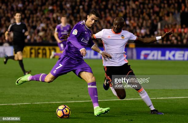 Real Madrid's Portuguese forward Cristiano Ronaldo vies with Valencia's French defender Eliaquim Mangala during the Spanish league football match...