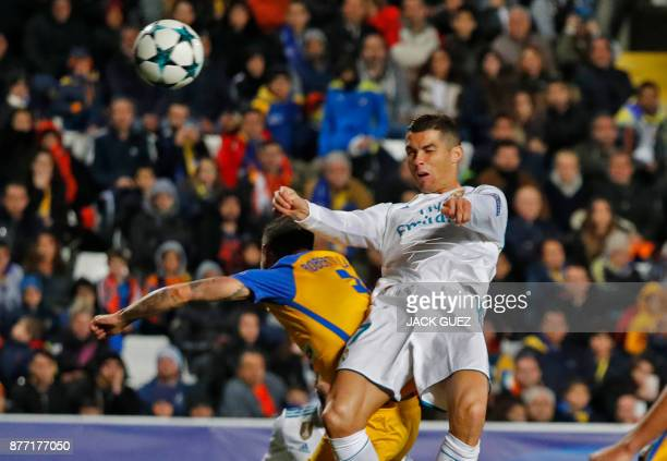 Real Madrid's Portuguese forward Cristiano Ronaldo views for the ball with Apoel's Spanish defender Roberto Lago during the UEFA Champions League...