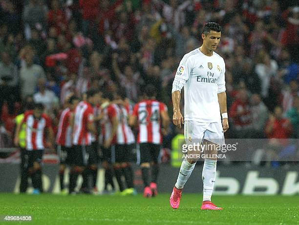 Real Madrid's Portuguese forward Cristiano Ronaldo walks after Athletic Bilbao scored during the Spanish league football match Athletic Club vs Real...