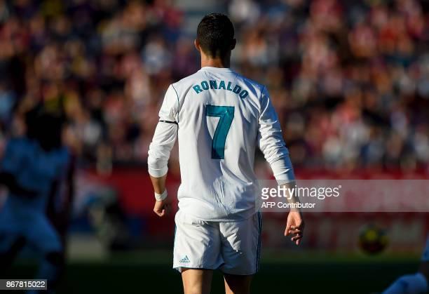 Real Madrid's Portuguese forward Cristiano Ronaldo walks on the field during the Spanish league football match Girona FC vs Real Madrid CF at the...