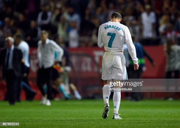 Real Madrid's Portuguese forward Cristiano Ronaldo walks on the field after a goal by Girona during the Spanish league football match Girona FC vs...