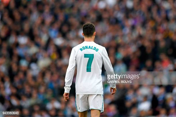 TOPSHOT Real Madrid's Portuguese forward Cristiano Ronaldo walks on the pitch during the Spanish league football match between Real Madrid CF and...
