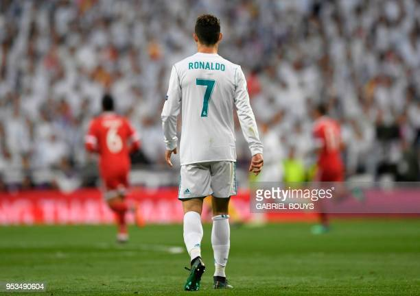 Real Madrid's Portuguese forward Cristiano Ronaldo walks on the pitch during the UEFA Champions League semifinal secondleg football match Real Madrid...