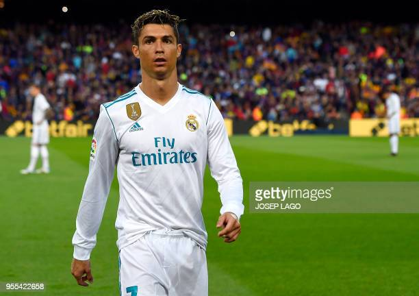 Real Madrid's Portuguese forward Cristiano Ronaldo walks on the pitch during the Spanish league football match between FC Barcelona and Real Madrid...