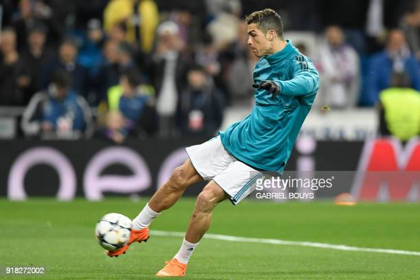 Real Madrid's Portuguese forward Cristiano Ronaldo warms up before the UEFA Champions League round of sixteen first leg football match Real Madrid CF...