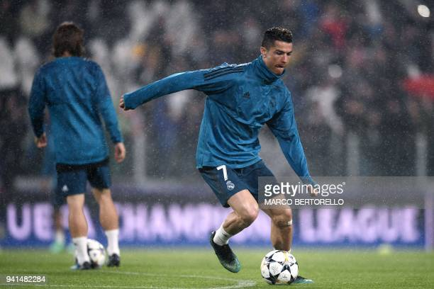 Real Madrid's Portuguese forward Cristiano Ronaldo warms up before the UEFA Champions League quarterfinal first leg football match between Juventus...
