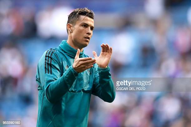 Real Madrid's Portuguese forward Cristiano Ronaldo warms up before the UEFA Champions League semifinal second leg football match between Real Madrid...