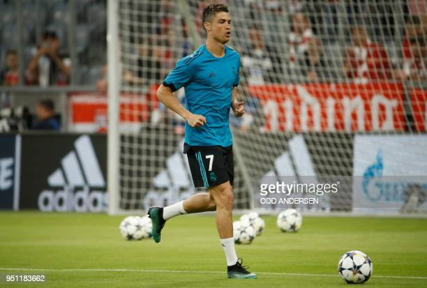 Real Madrid's Portuguese forward Cristiano Ronaldo warms up on the ball prior to the during the UEFA Champions League semifinal firstleg football...