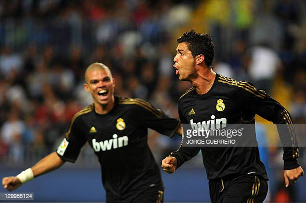 Real Madrid's Portuguese forward Cristiano Ronaldo with Real Madrid's Portuguese defender Pepe celebrate after scoring during the Spanish league...
