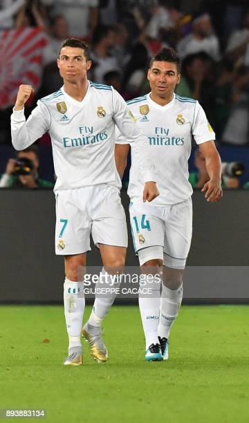 Real Madrid's Portuguese forward Ronaldo celebrates with teammate Casemiro after scoring during their FIFA Club World Cup 2017 final football match...