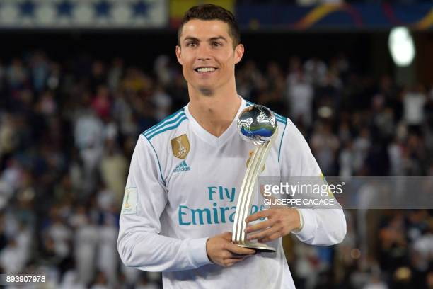 Real Madrid's Portuguese forward Ronaldo celebrates with the 2017 FIFA Club World Cup Silver Ball award following their victory in the Club World Cup...