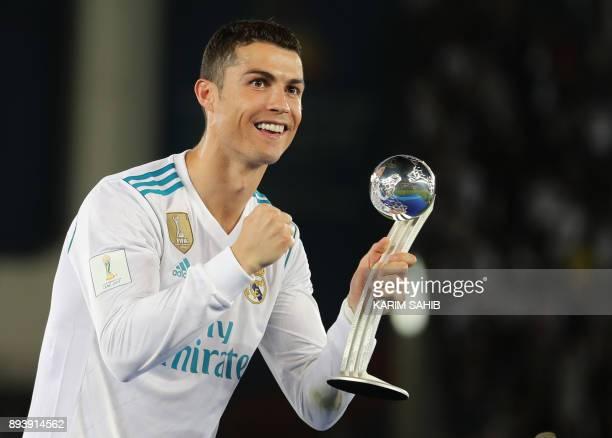 Real Madrid's Portuguese forward Ronaldo celebrates with the 2017 FIFA Club World Cup Silver Ball after real Madrid's victory in the the FIFA Club...