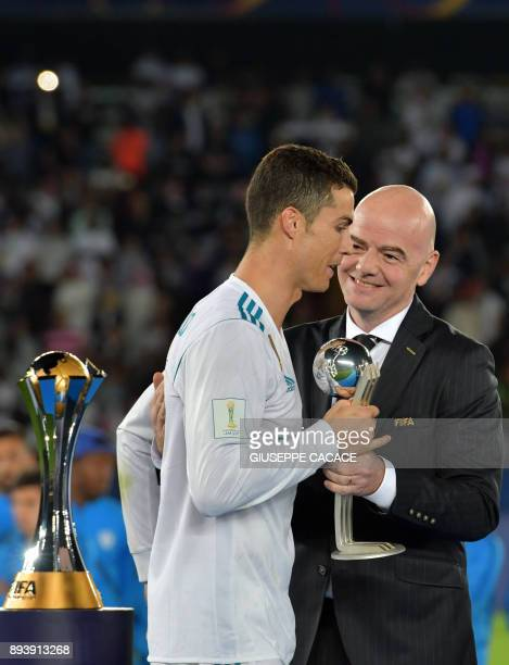 Real Madrid's Portuguese forward Ronaldo is presented with the 2017 FIFA Club World Cup Silver Ball award by FIFA President Gianni Infantino...