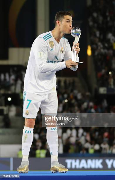 Real Madrid's Portuguese forward Ronaldo kisses the 2017 FIFA Club World Cup Silver Ball after real Madrid's victory in the the FIFA Club World Cup...