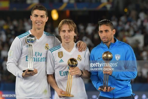 Real Madrid's Portuguese forward Ronaldo Real Madrid's Croatian midfielder Luka Modric and Pachuca's Uruguayan winger Jonathan Urretaviscaya pose...