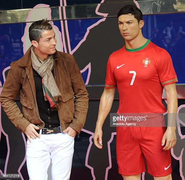 Real Madrid's Portuguese player Cristiano Ronaldo looks at his wax figure during its presentation ceremony at the Wax Museum in Madrid Spain on...