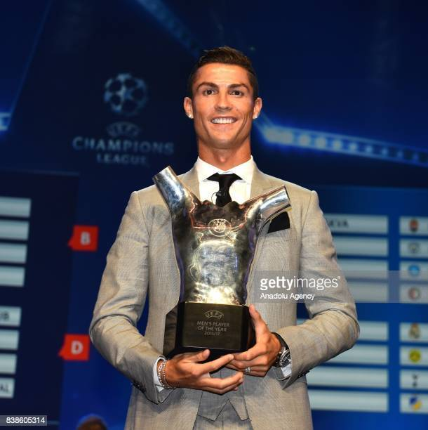 Real Madrid's Portuguese player Cristiano Ronaldo poses with his trophy of Best Men's player in Europe at the end of the UEFA Champions League Group...