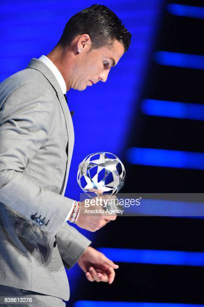 Real Madrid's Portuguese player Cristiano Ronaldo poses with his trophy of Best Men's player in Europe after the UEFA Champions League Group stage...