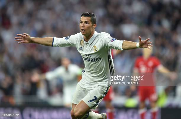 Real Madrid's Portuguese striker Cristiano Ronaldo celebrates after his second goal during the UEFA Champions League quarterfinal second leg football...