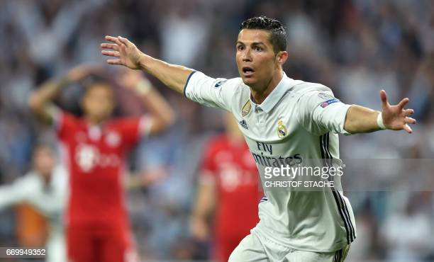 TOPSHOT Real Madrid's Portuguese striker Cristiano Ronaldo celebrates after his second goal during the UEFA Champions League quarterfinal second leg...