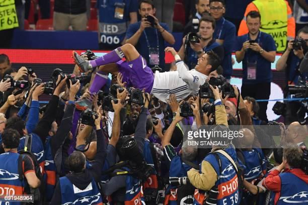TOPSHOT Real Madrid's Portuguese striker Cristiano Ronaldo celebrates after winning the UEFA Champions League final football match between Juventus...
