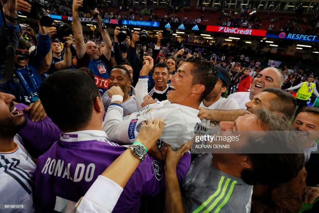 Real Madrid's Portuguese striker Cristiano Ronaldo celebrates after Real Madrid won the UEFA Champions League final football match between Juventus and Real Madrid at The Principality Stadium in Cardiff, south Wales, on June 3, 2017. / AFP PHOTO / Adrian DENNIS