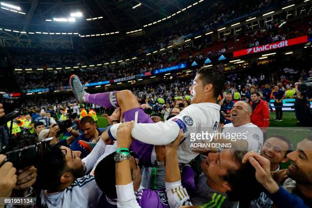 Real Madrid's Portuguese striker Cristiano Ronaldo celebrates after Real Madrid won the UEFA Champions League final football match between Juventus...