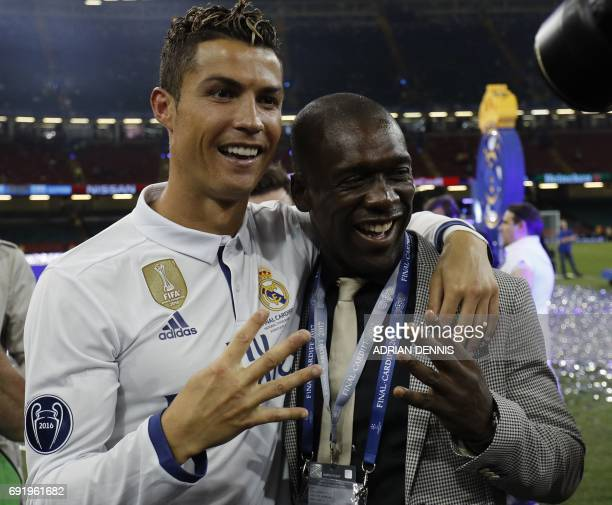 Real Madrid's Portuguese striker Cristiano Ronaldo celebrates Dutch football manager and former player Clarence Clyde Seedorf after Real Madrid won...
