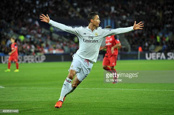 Real Madrid's Portuguese striker Cristiano Ronaldo celebrates scoring his second goal during the UEFA Super Cup football match between Real Madrid...