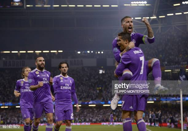 TOPSHOT Real Madrid's Portuguese striker Cristiano Ronaldo celebrates with Real Madrid's Spanish defender Sergio Ramos after scoring during the UEFA...