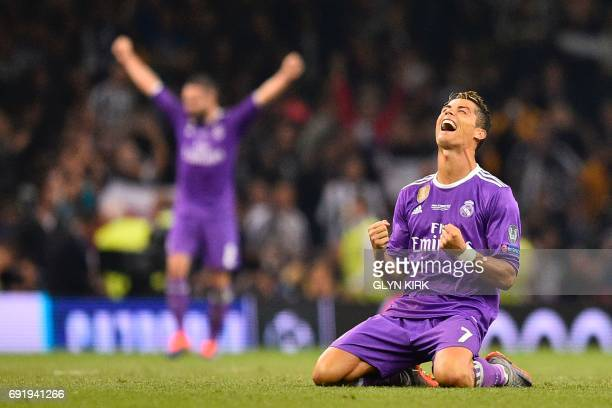 TOPSHOT Real Madrid's Portuguese striker Cristiano Ronaldo falls to his knees as he celebrates their victory on the final whistle of the UEFA...