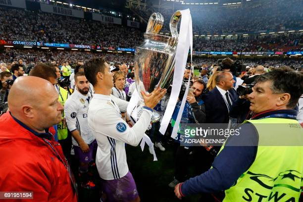 Real Madrid's Portuguese striker Cristiano Ronaldo holds the trophy after Real Madrid won the UEFA Champions League final football match between...