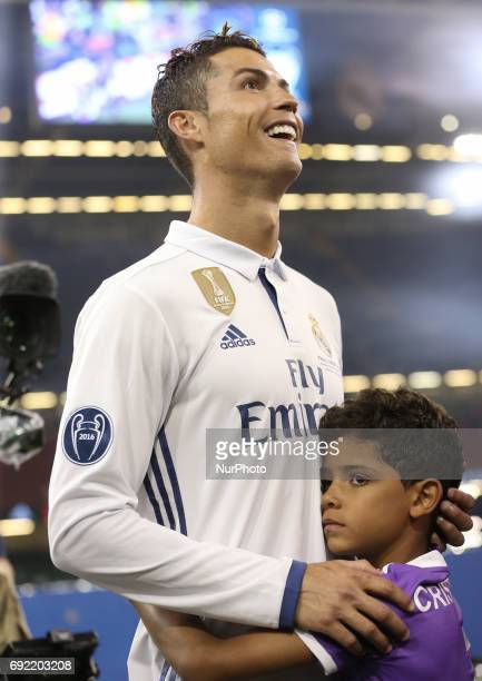 Real Madrid's Portuguese striker Cristiano Ronaldo is hugged by his son Cristiano Ronaldo Jr after Real Madrid won the UEFA Champions League final...