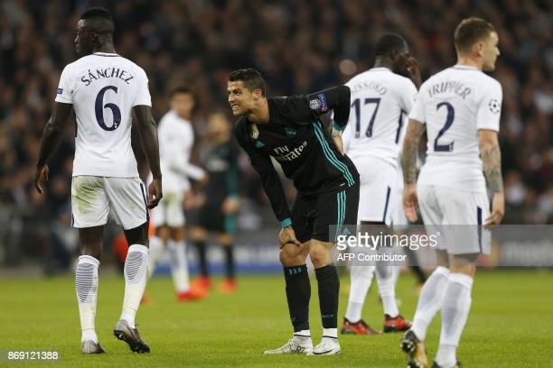 TOPSHOT Real Madrid's Portuguese striker Cristiano Ronaldo reacts after missing a shot on goal during the UEFA Champions League Group H football...