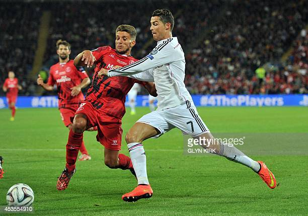 Real Madrid's Portuguese striker Cristiano Ronaldo vies with Sevilla's Portuguese defender Daniel Carrico during the UEFA Super Cup football match...