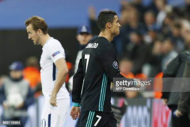 Real Madrid's Portuguese striker Cristiano Ronaldo walks off the pitch by Tottenham Hotspur's English striker Harry Kane after losing the UEFA...