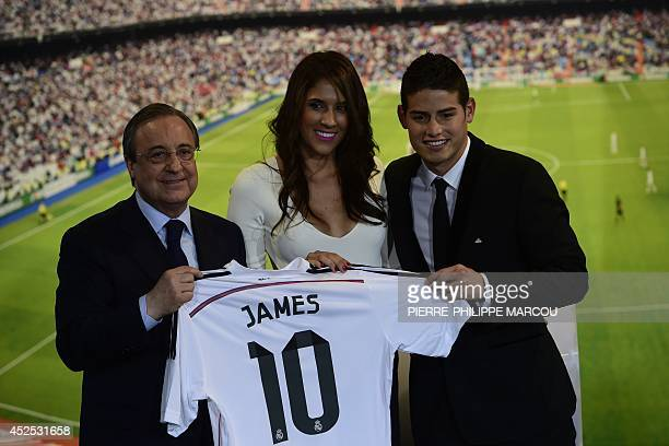 Real Madrid's President Florentino Perez Colombian striker formerly at AS Monaco James Rodriguez and his wife Daniela Ospina pose during his...