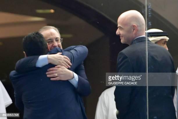 Real Madrid's President Florentino Perez hugs Diego Maradona retired Argentine footballing legend and alFujairah head coach as Fifa President Gianni...