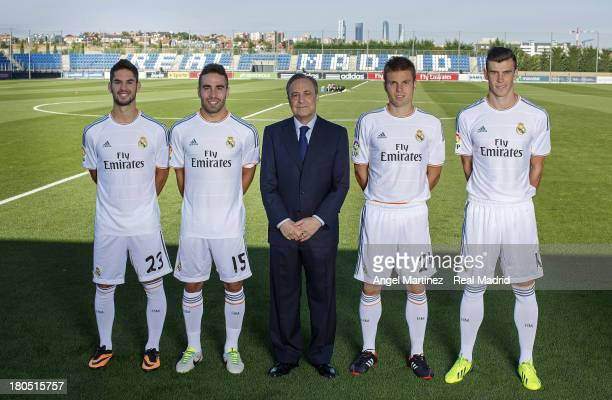 Real Madrid's President Florentino Perez poses with Isco Daniel Carvajal Asier Illarramendi and Gareth Bale during the official team photo session at...