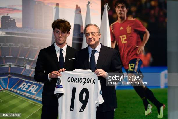 Real Madrid's president Florentino Perez poses with Real Madrid's new defender Alvaro Odriozola during his official presentation at the Santiago...